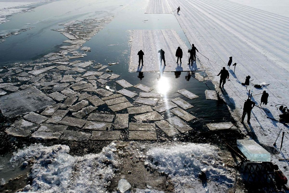 An aerial view shows floating ice blocks cut from the frozen surface of Xiuhu lake in Shenyang, northeastern China's Liaoning province on December 20, 2017. The ice blocks are used as part of winter tourism activities in the region. PHOTO: AFP