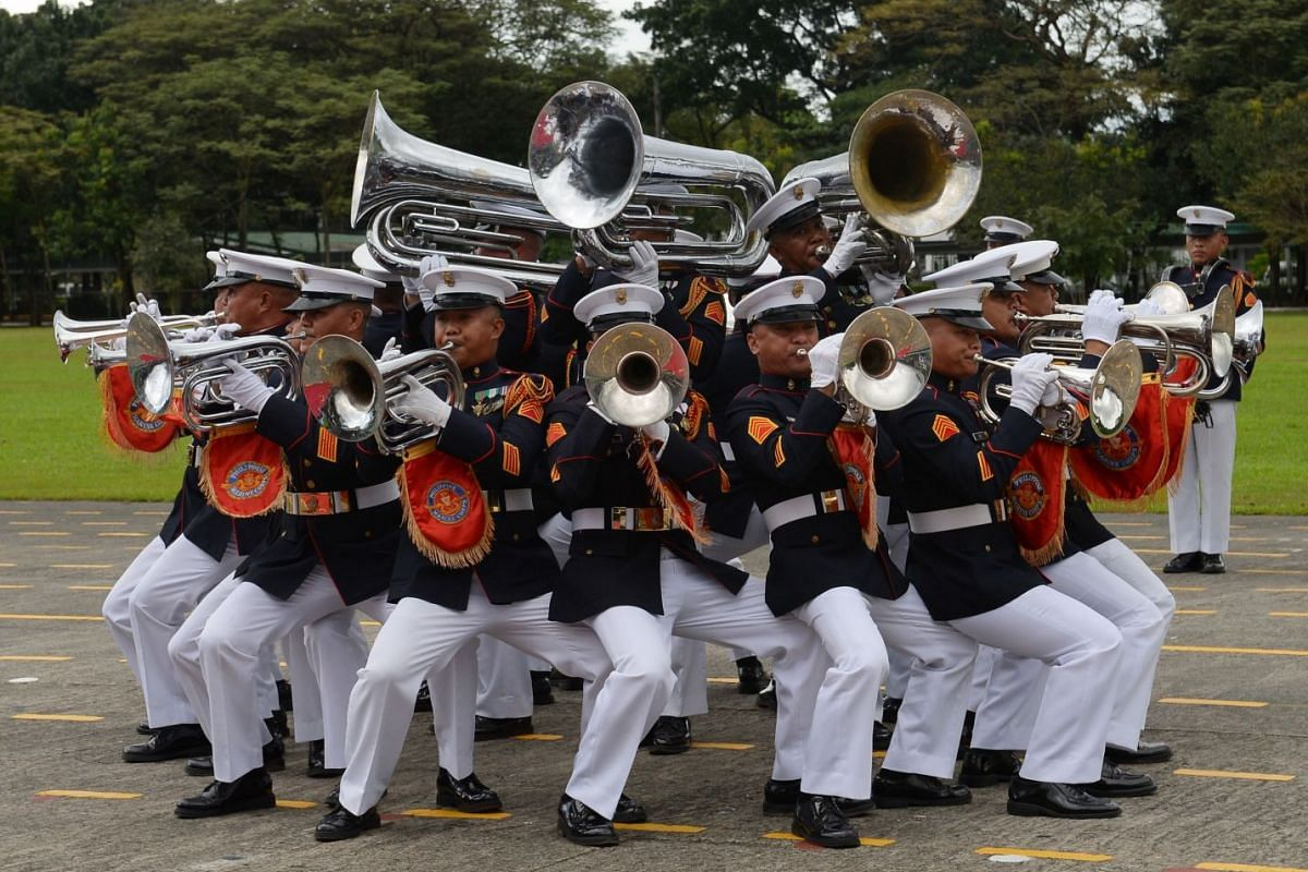 Members of the Philippines' military brass band perform during a ceremony marking the anniversary of the military at Camp Aguinaldo in Quezon City, suburban Manila on December 20, 2017, attended by President Rodrigo Duterte. PHOTO: AFP
