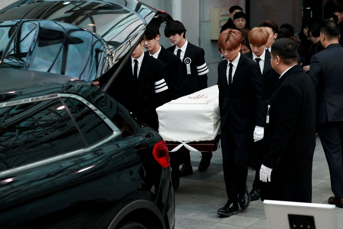 The coffin of Kim Jong Hyun is carried by his celebrity colleagues to a hearse during his funeral at a hospital in Seoul on Dec 21, 2017.