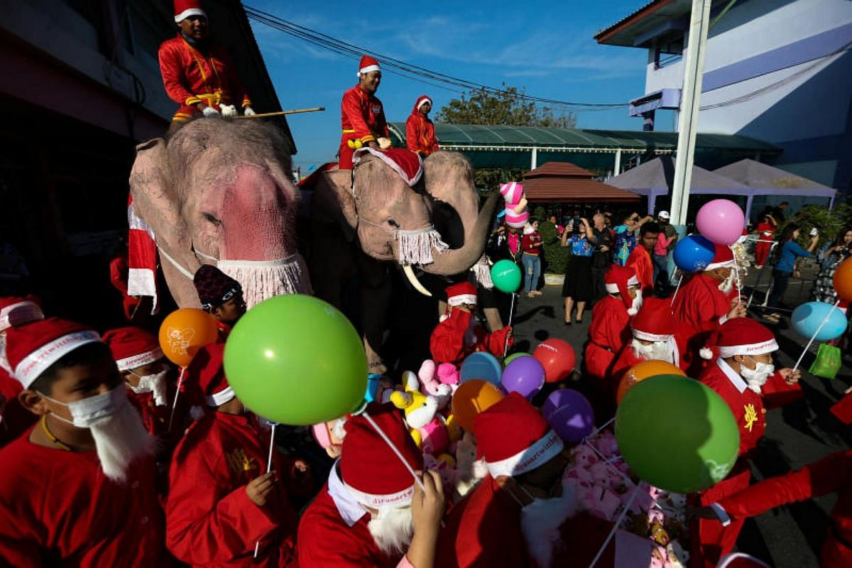 Elephants, teachers and students dressed in Santa Claus costumes parade during the Christmas celebrations at Jirasart school in Ayutthaya, Thailand, on Dec 22, 2017.