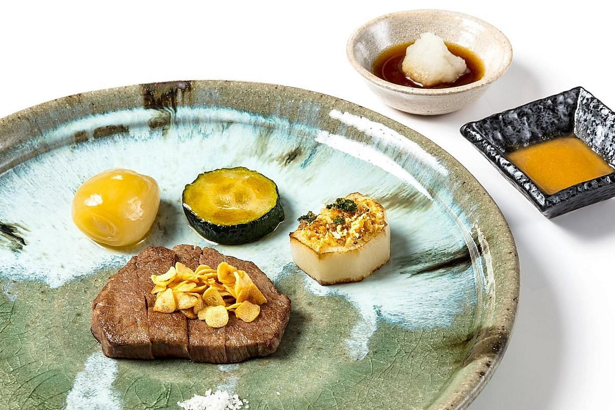 Teppan by Chef Yonemura's Japanese Wagyu Beef Fillet with Turnip, Zucchini and Simmered Deep-fried Shallots (above) and Live Prawn and Abalone Stuffed Tomato (left).