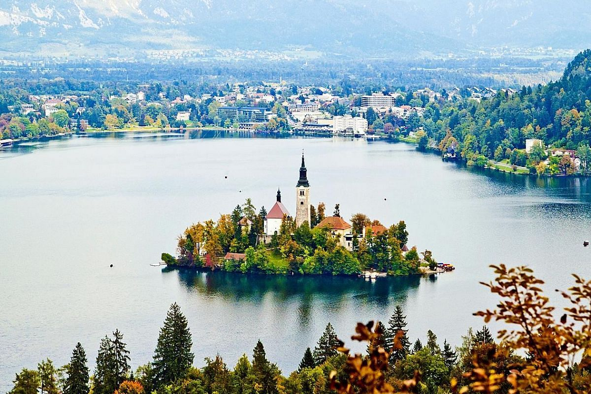 Lake Bled (above), with its fairy-tale, church-crowned island in the middle of a pristine lake; and the Predjama castle (left), a dramatic Renaissance castle built into a cave within the Karst region. The Franciscan Church of the Annunciation and the