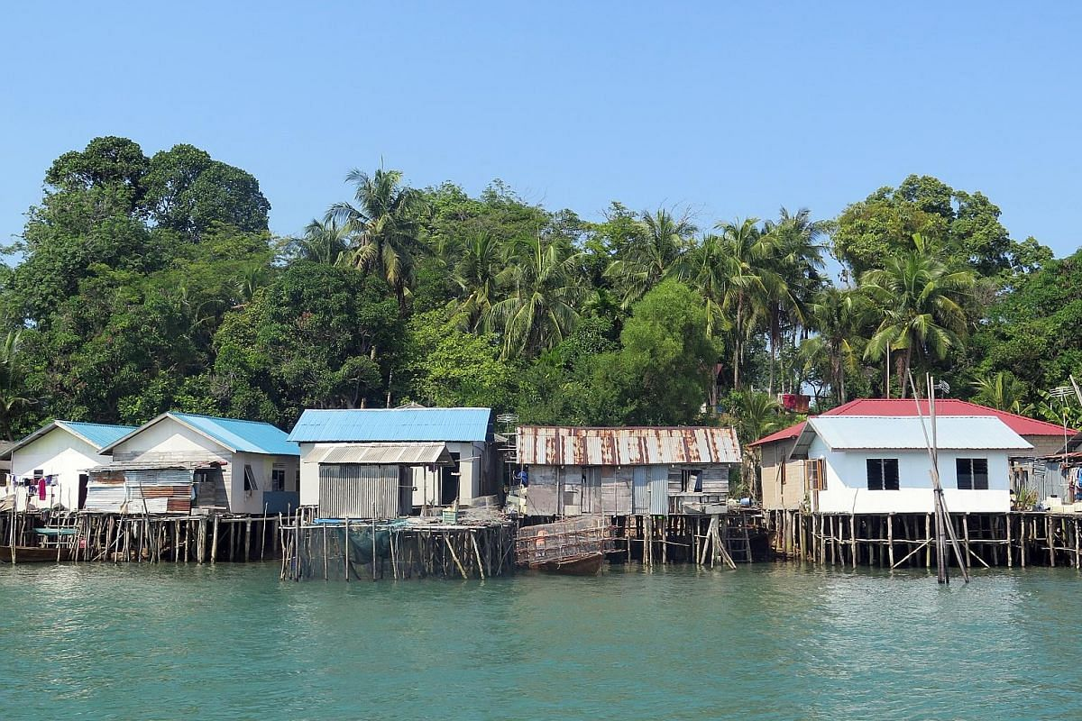 Batam's sea gypsy community live in huts (above) built over the water and local village life (below) moves at an easy pace. A kelong restaurant in Batam that serves seafood fresh from the ocean. The five-star Radisson Golf & Convention Center Batam (