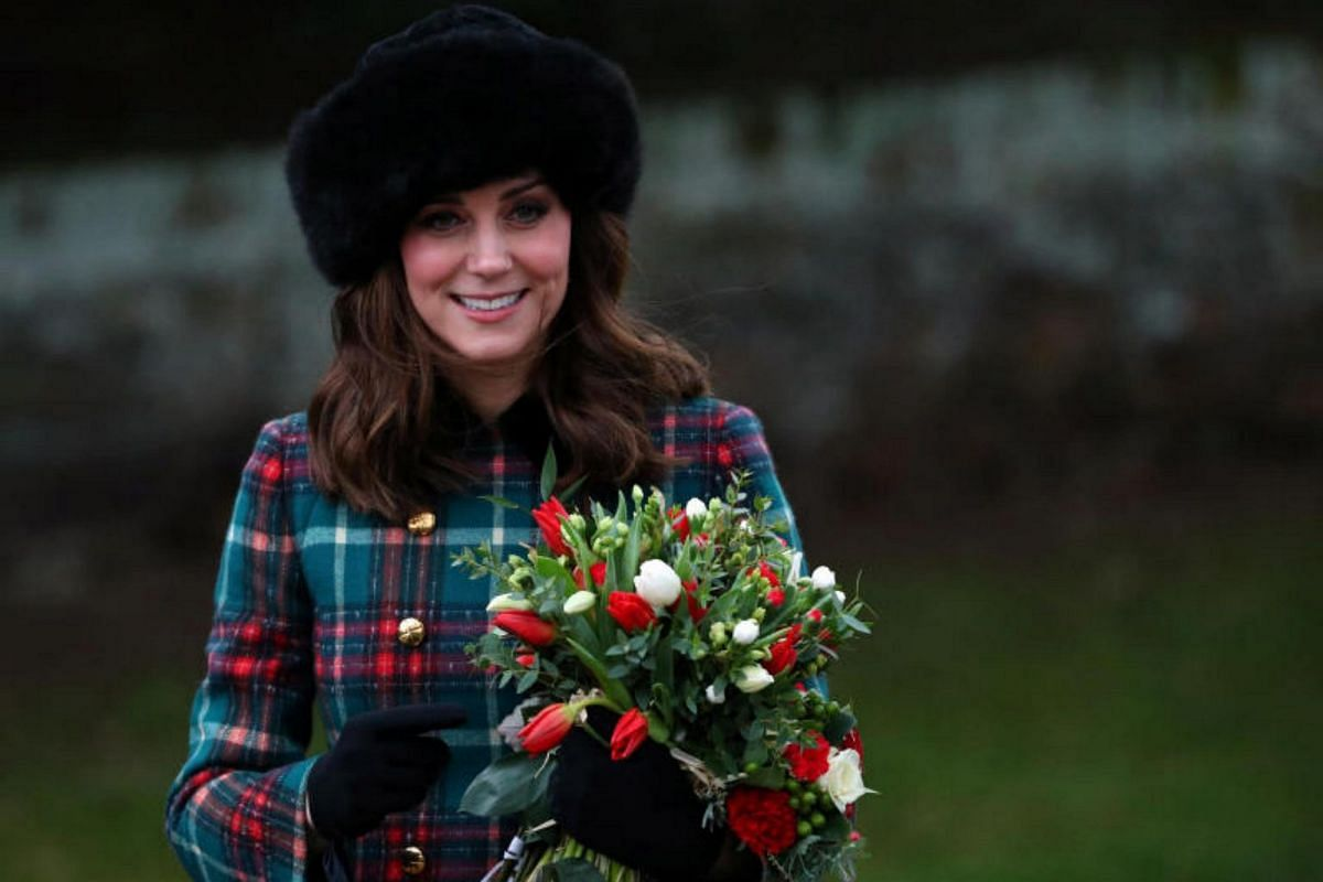 Catherine, the Duchess of Cambridge, posing with flowers after the Royal Family's annual Christmas Day service.