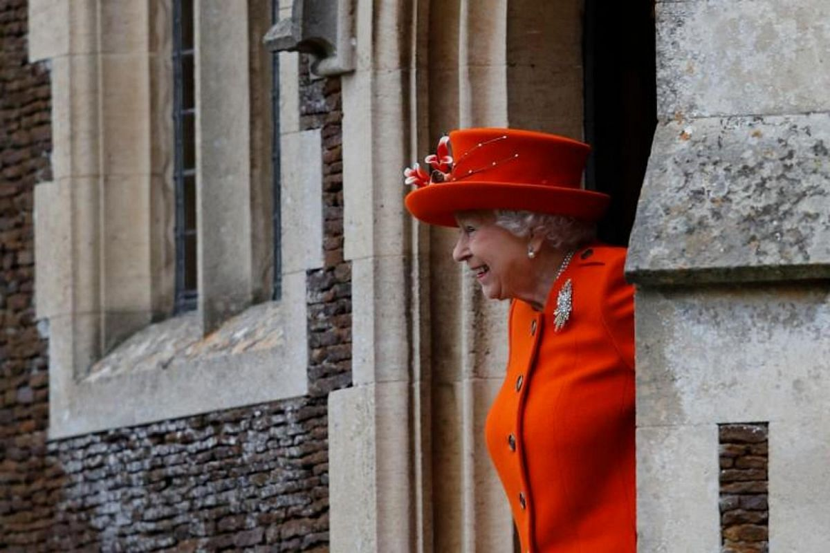 Queen Elizabeth II stepping out of St Mary Magdalene Church following the annual Christmas Day service.