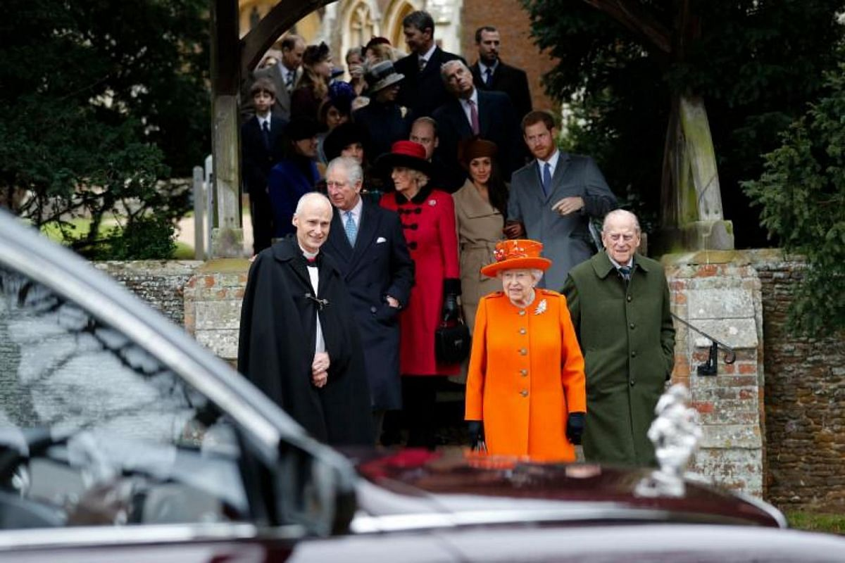 Britain's Queen Elizabeth II, flanked by her husband, Prince Philip (right) and the Reverend Canon Jonathan Riviere, leaving the church following the service.