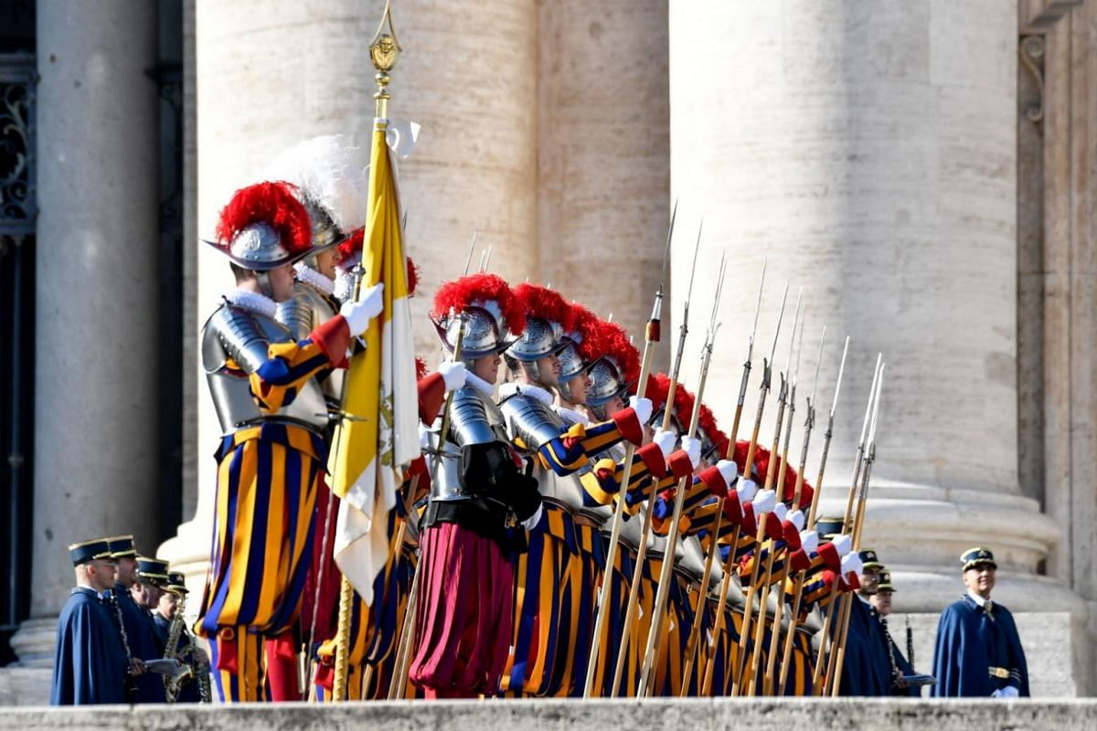 """Swiss guards arrive to take position before the traditional """"Urbi et Orbi"""" Christmas address and blessing given to the city of Rome and to the world by Pope Francis."""