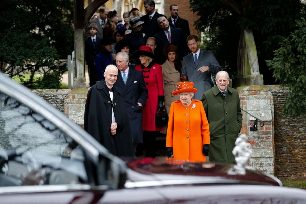 Britain's Queen Elizabeth II and Britain's Prince Philip, Duke of Edinburgh, lead out other members of the family with Reverend Canon Jonathan Riviere as they leave after attending the Royal Family's traditional Christmas Day church service at St Mar