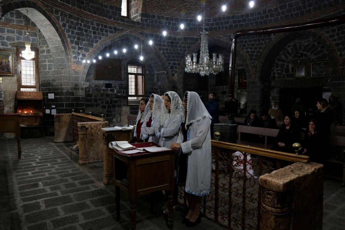 Syriac Christian girls, who are members of the choir, attend a mass on Christmas at the Virgin Mary Syriac Orthodox Church in Diyarbakir, Turkey.