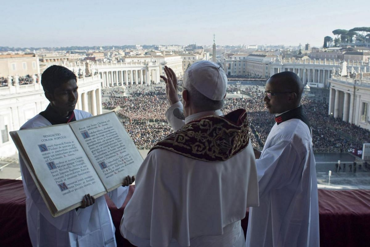 """Pope Francis delivers the traditional """"Urbi et Orbi"""" Christmas Day blessing from the central balcony of St. Peter's Basilica at the Vatican."""