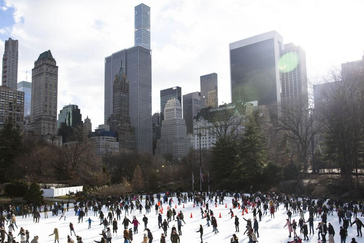 People skate at Central Park ice rink on Christmas Day in New York City.