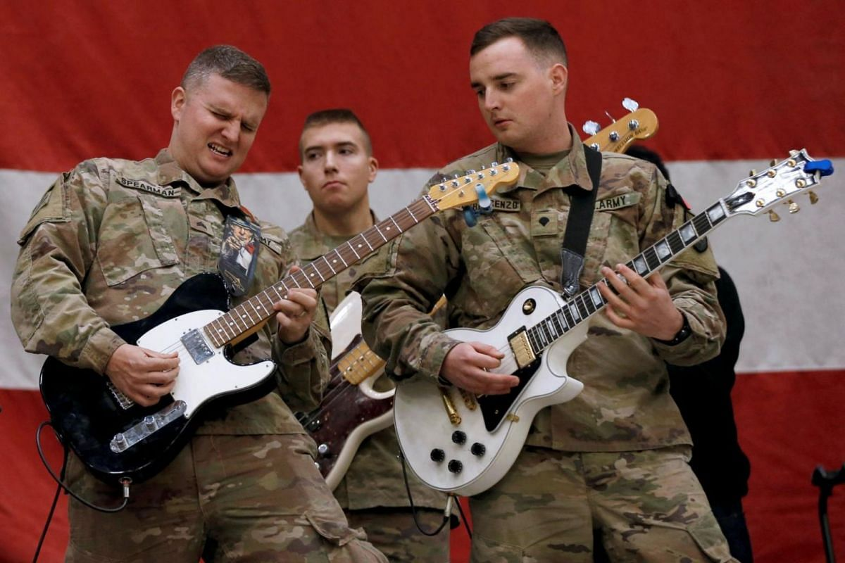 Members of the US army performing during Christmas Eve celebrations at an airfield in Bagram, north of Kabul, Afghanistan.