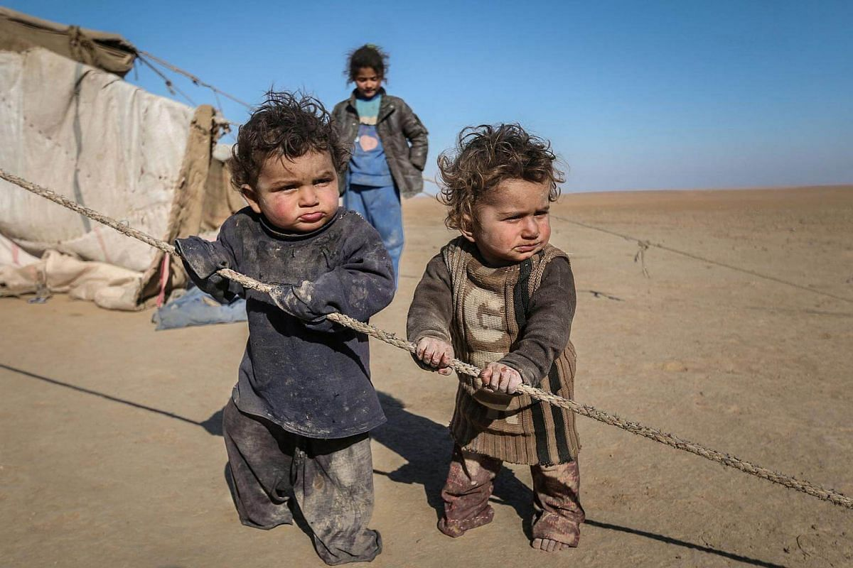 Internally displaced Syrian children who fled Raqqa city stand near their tent in Ras al-Ain province, Syria, on Jan 22, 2017.