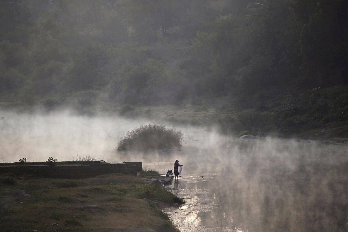 A file photo of a woman washing clothes in the river Cauvery, on a cold winter morning in Kushalnagar town, Karnataka, India, on Dec 31, 2015.
