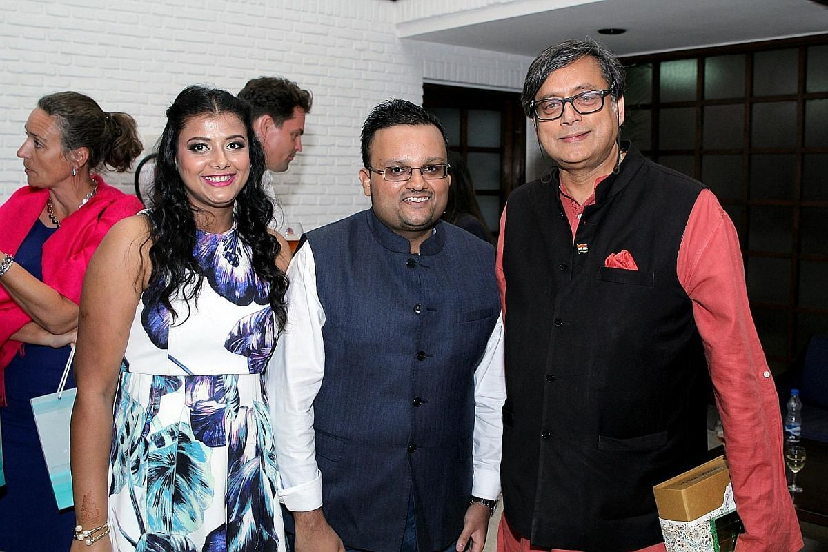 Delhi Book Lovers founders Meenakshi Goyal and Kunal Gupta with opposition politician Shashi Tharoor (far right), who wrote An Era Of Darkness: The British Empire In India. Far left: Indian author Parul Sharma reading excerpts from her book, Tuki's G