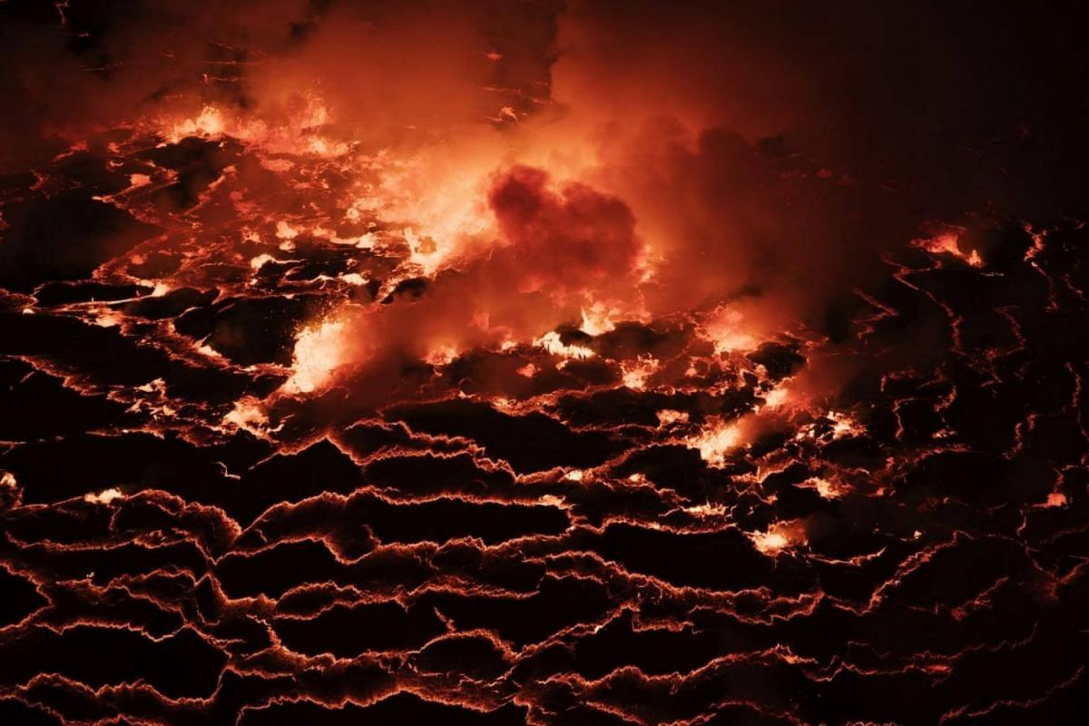 Climb to the top of Mount Nyiragongo in the Democratic Republic of Congo to look into its fiery lava lake.
