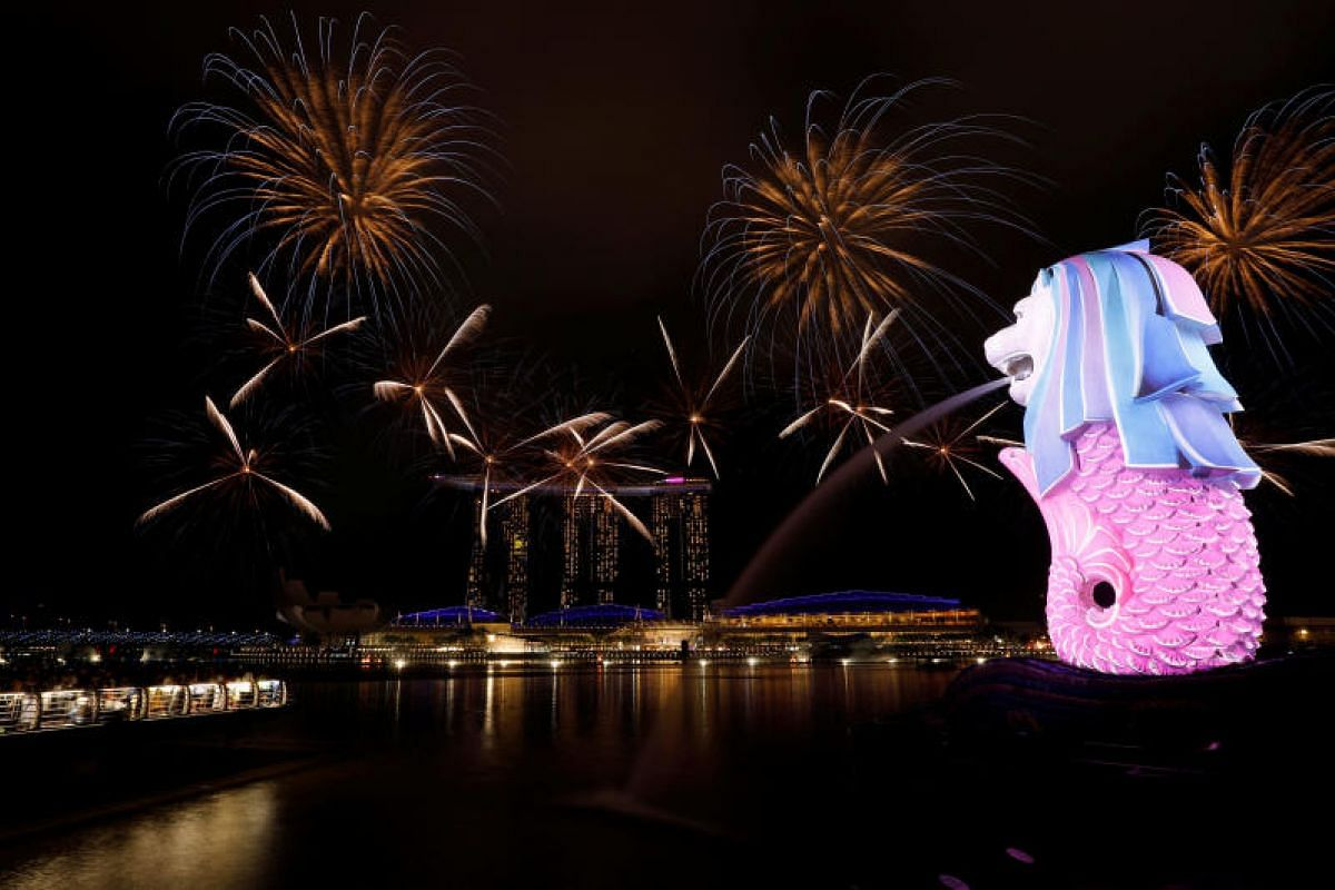 Fireworks light up Marina Bay near the Merlion ahead of the New Year in Singapore on Dec 31, 2017.
