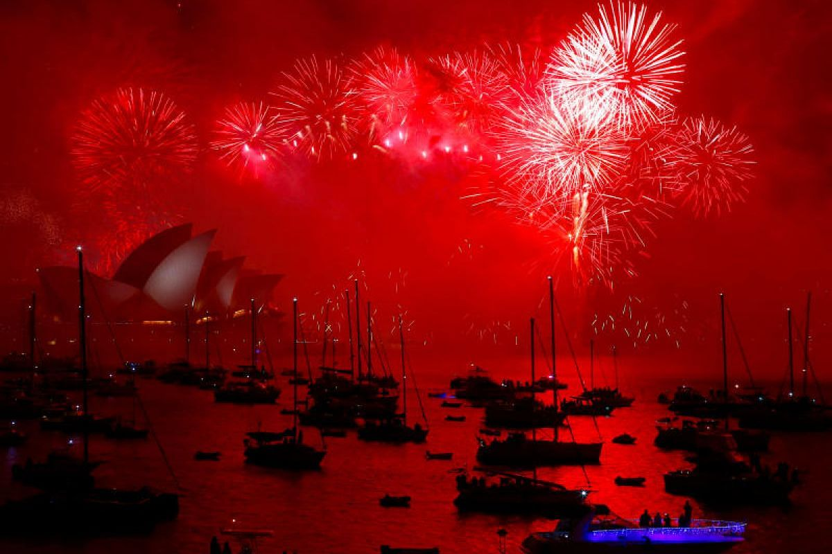 Fireworks light up the Sydney Harbour Bridge and Sydney Opera House during new year celebrations on Sydney Harbour, Australia, on Jan 1, 2018.
