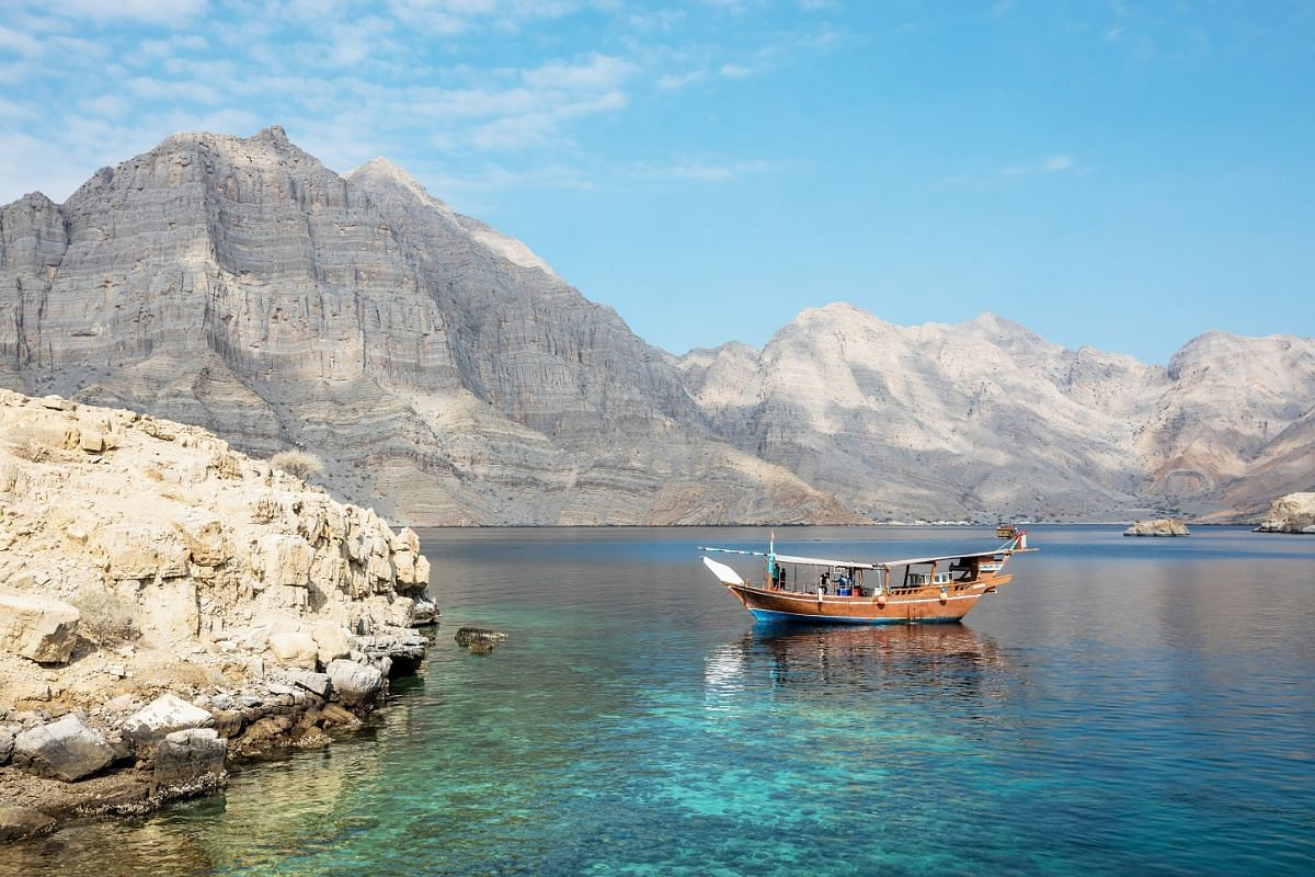 Explore the fjords near Khasab in Oman, which offers more than just the desert experience.