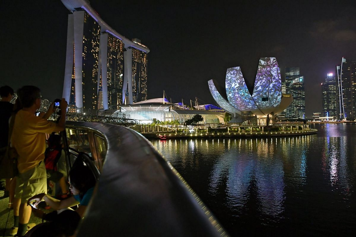 A visual spectacle takes place on the facades of The Fullerton Hotel Singapore, Merlion and ArtScience Museum (above) on the hour from 8pm tonight. One of three projection towers around the Merlion from which the light show is projected.