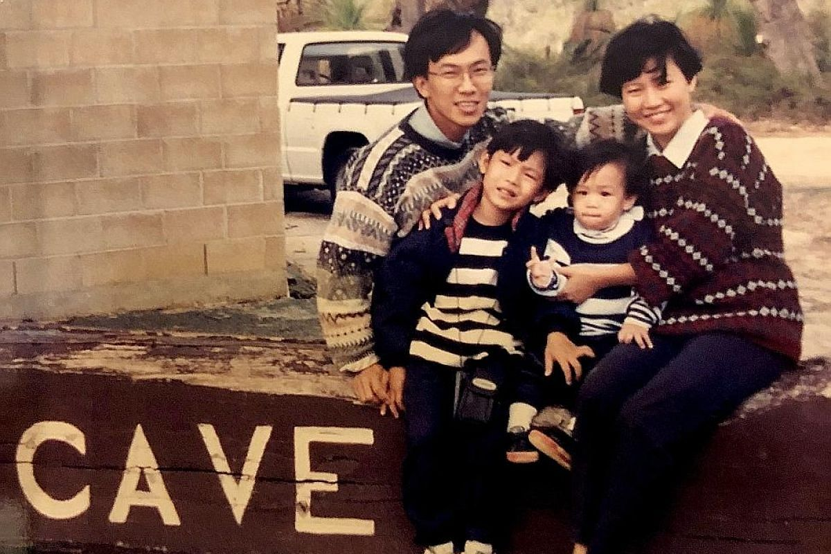 Siblings Silas (left) and Shamus Hwang on holiday with their parents, David Hwang and Brenice Ong, when they were kids.