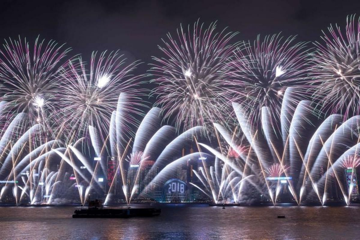Fireworks explode over Victoria harbour during New Year celebrations in Hong Kong on Jan 1, 2018.