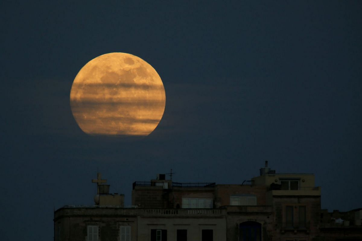 A 'supermoon' full moon is seen rising in Pieta, Malta, January 1, 2018. PHOTO: REUTERS