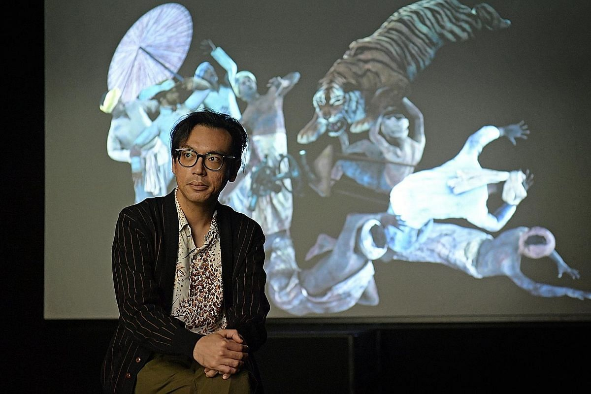 Viewers can make their own creations using pillows with strings attached in Pinaree Sanpitak's The House Is Crumbling. (Above) Ho Tzu Nyen with his work, One Or Several Tigers. (Left) Opera singers will offer personal concerts as part of the work Son