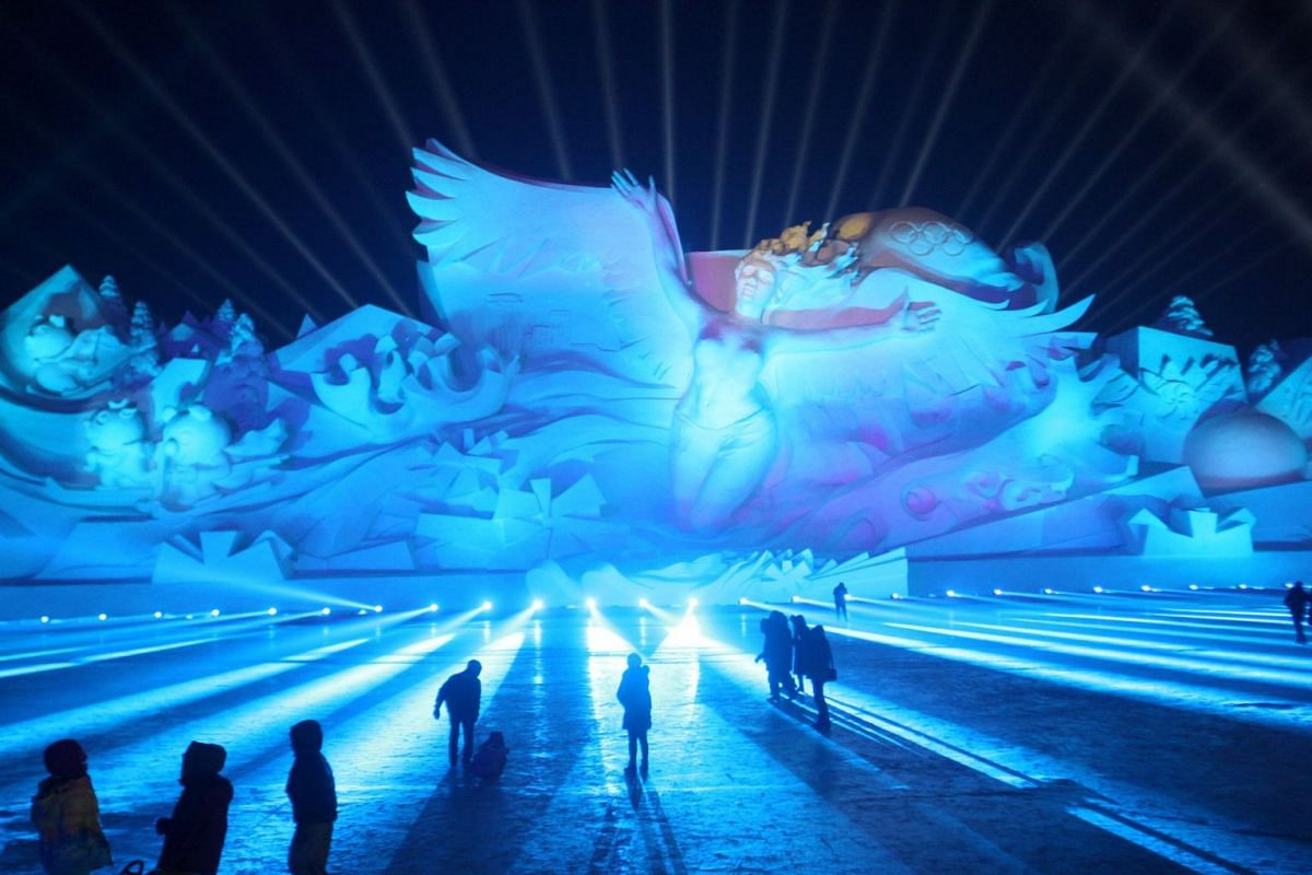A photo released on Jan 3, 2018 shows visitors attending a 3D light show at the Harbin Sun Island International Snow Sculpture Art Expo in Harbin, Heilongjiang province, China January 1, 2018. PHOTO: REUTERS