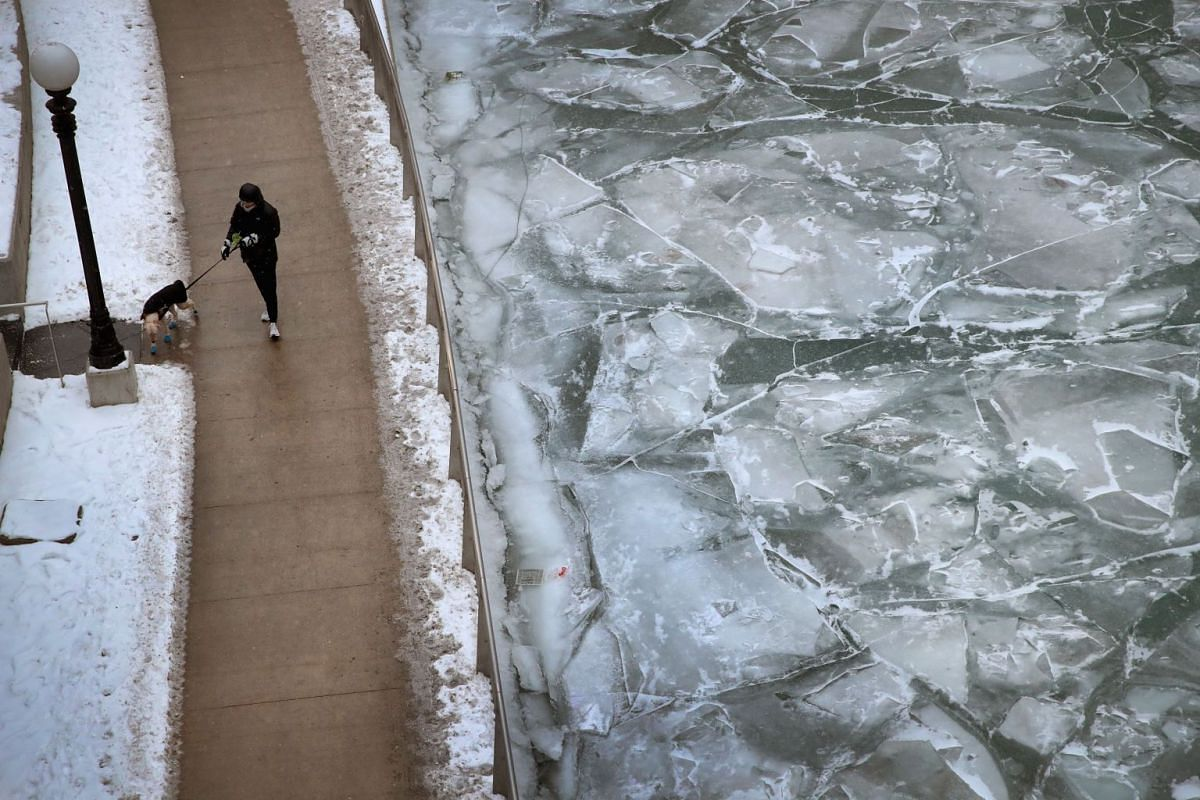 Ice collects on the Chicago river on Jan 3, 2018. Record cold temperatures are gripping much of the US and are being blamed on several deaths over the past week.