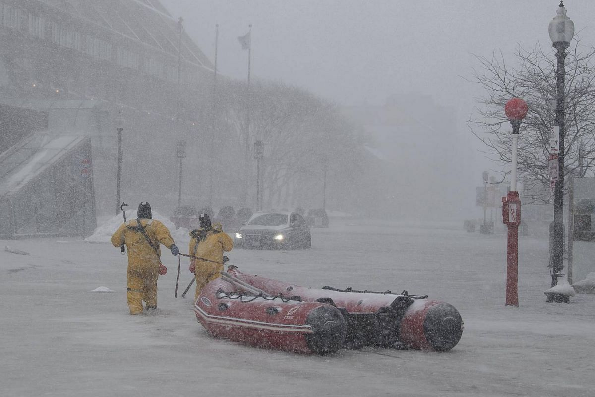 Boston firefighters donning ice rescue suits to rescue a stranded motorist, in Boston, on Jan 4, 2018.