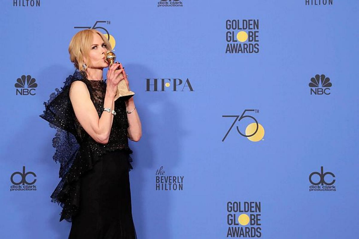 Nicole Kidman holds the award for the Best Performance by an Actress in a Limited Series or a Motion Picture Made for Television for Big Little Lies in the press room during the 75th annual Golden Globe Awards.