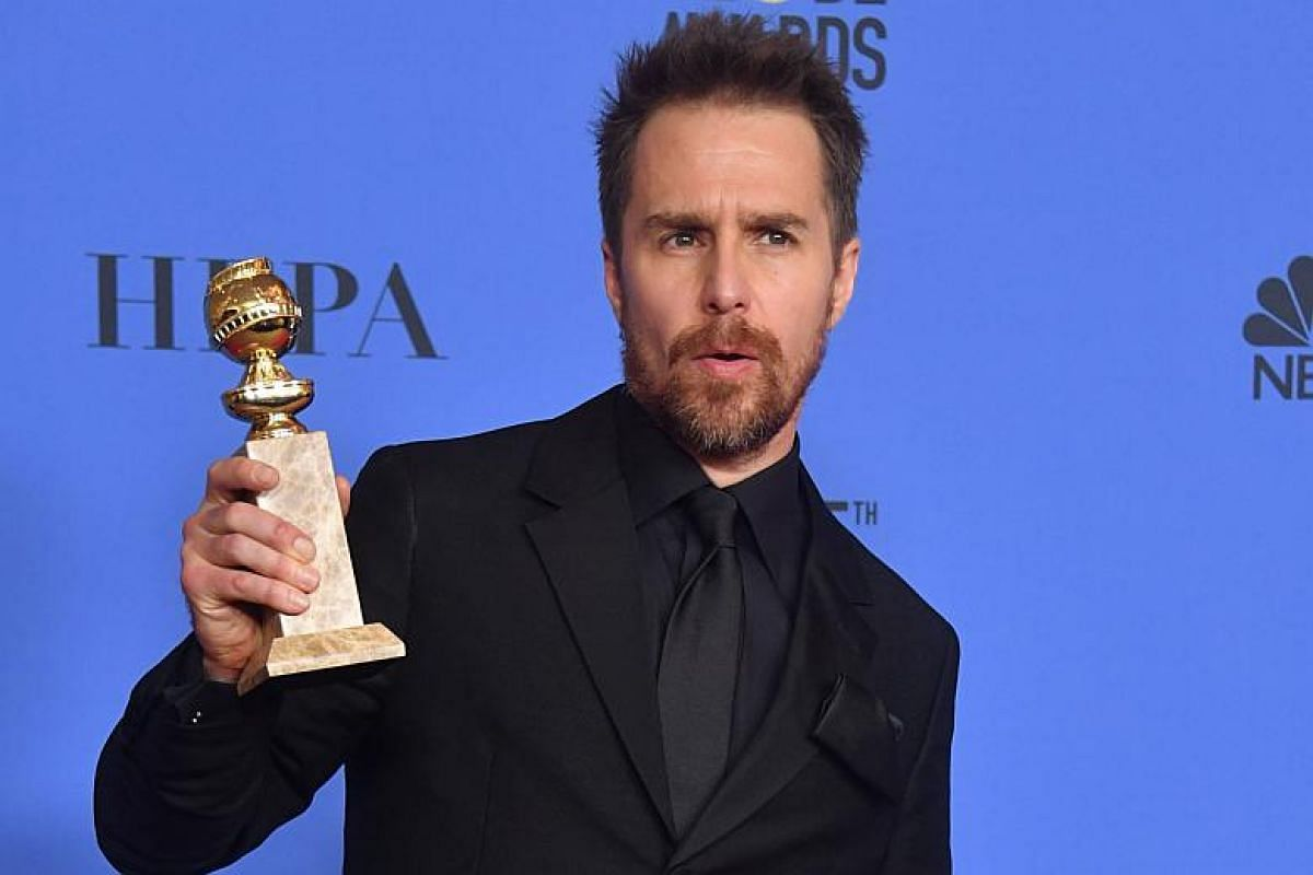 Actor Sam Rockwell poses with the trophy for Best Performance by an Actor in a Supporting Role in any Motion Picture during the 75th Golden Globe Awards.