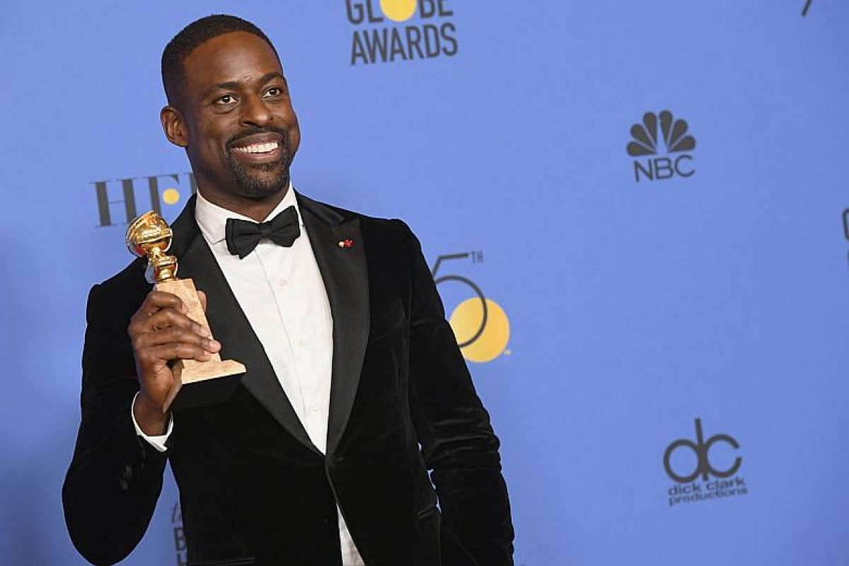 Actor Sterling K. Brown holds his award for Best Performance by an Actor In A Television Series Drama for This Is Us in the press room during the 75th Annual Golden Globe Awards.