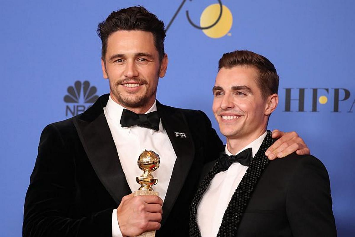 James Franco (left) poses with his brother, Dave, backstage after winning the award for Best Performance by an Actor in a Motion Picture - Musical or Comedy for The Disaster Artist.