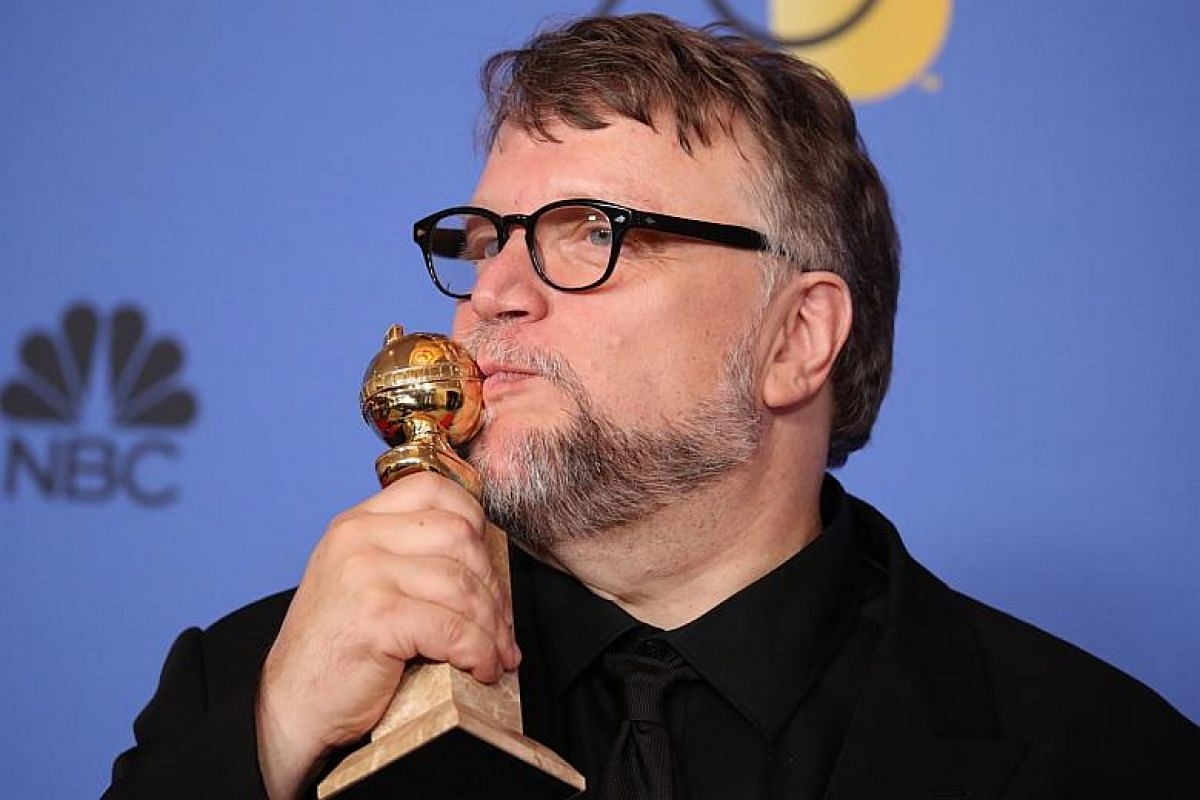 Guillermo del Toro poses backstage with the award for Best Director - Motion Picture for The Shape of Water.