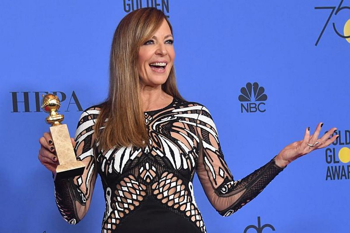 Actress Allison Janney poses with the trophy for Best Performance by an Actress in a Supporting Role in any Movie during the 75th Golden Globe Awards.