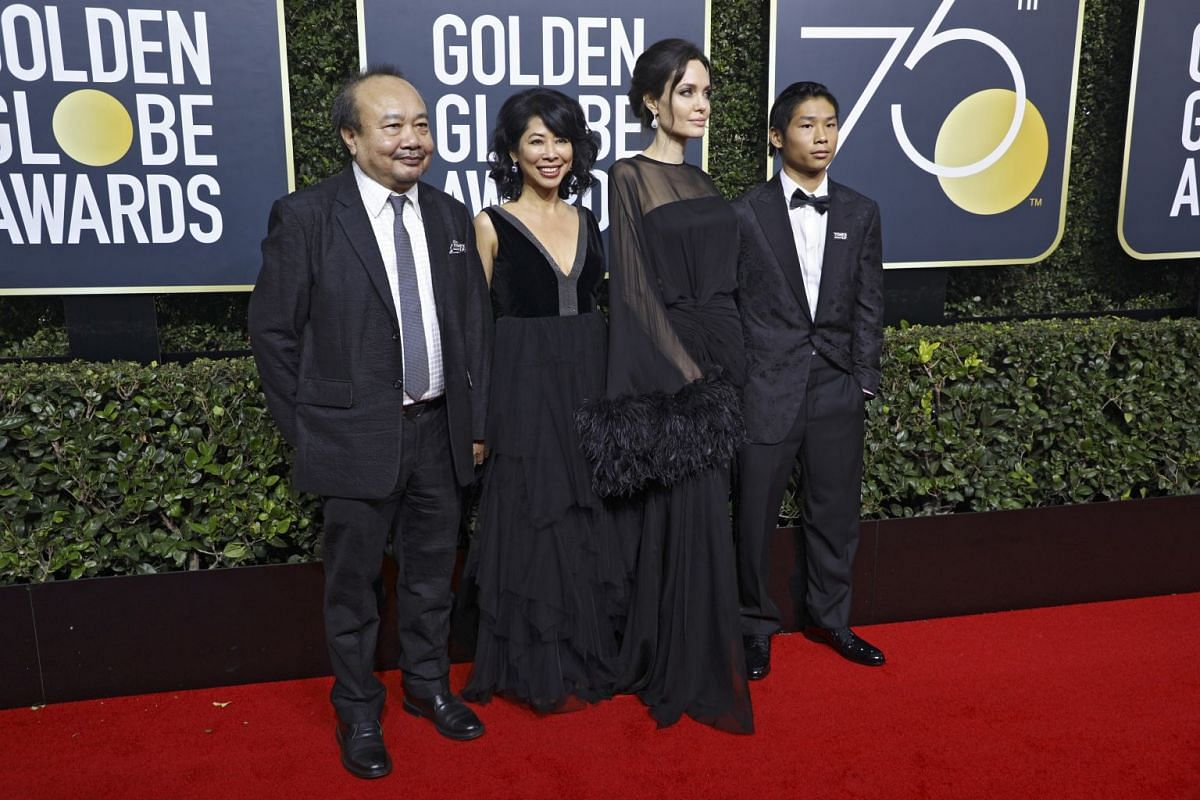 (From left) Cambodian film producer Rithy Panh, Cambodian-born activist and author Loung Ung, actress Angelina Jolie and her son Pax