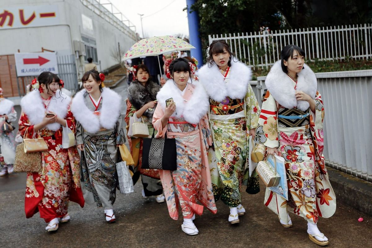 Young Japanese women dressed in colorful kimonos gather for a ceremony marking the 'Coming of Age Day' at Toshimaen Amusement Park in Tokyo, Japan, 08 January 2018. Coming of Age Day is a celebration for the youth who reach the age of 20 years old, w