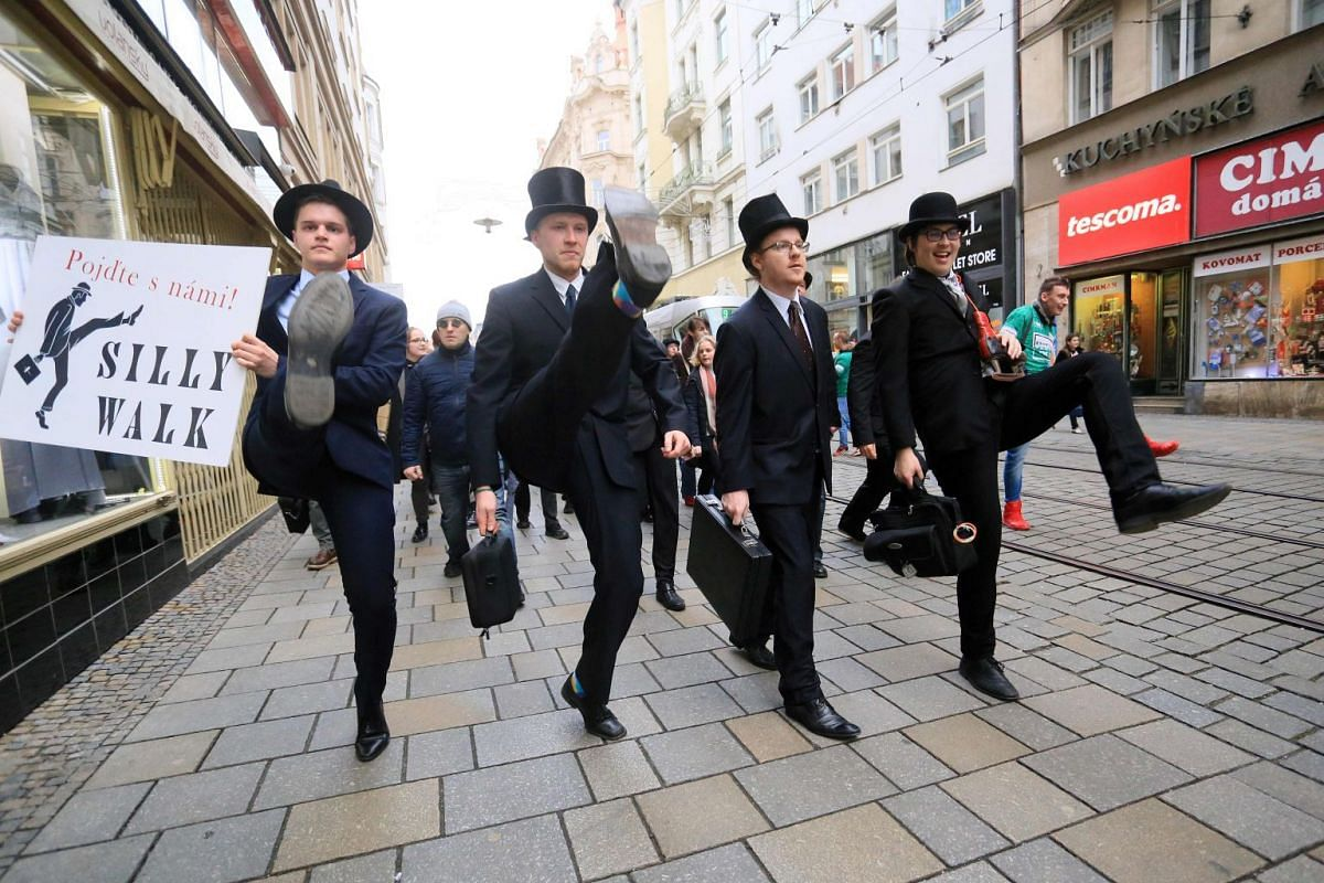 More than 300 people dressed in costumes perform the cult comedy Monty Python's Silly Walk on January 7 in Brno, Czech Republic, marking the International Silly Walk Day. PHOTO: AFP