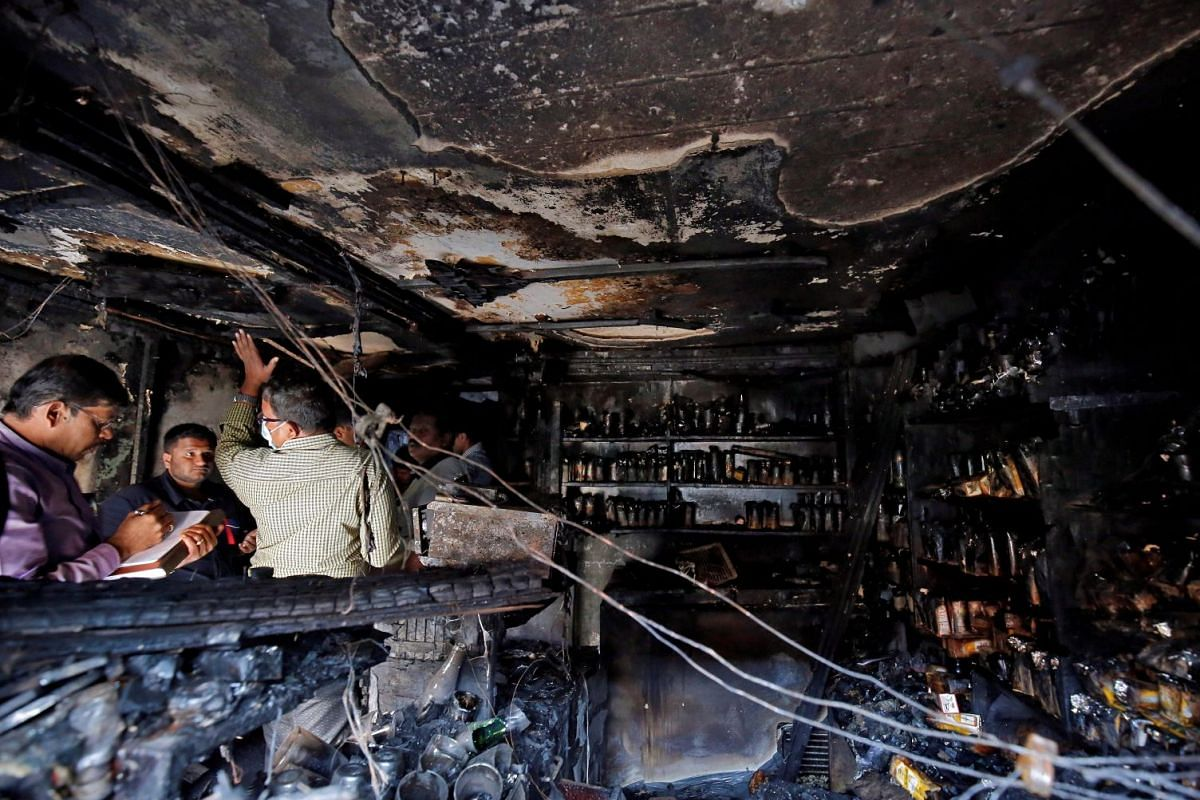 Forensic officials inspect inside a burnt restaurant after a fire in which, according to local media, five people died in Bengaluru, India, January 8, 2018. PHOTO: REUTERS