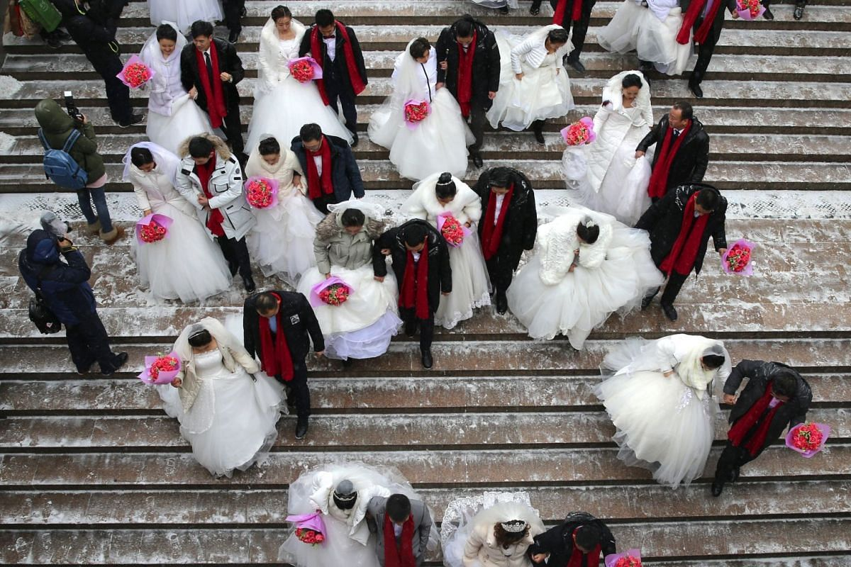 Chinese newlywed couples walk together during a collective wedding ceremony at the 34th Harbin International Ice and Snow Festival in Harbin, China's northeastern Heilongjiang province, 08 January 2018. PHOTO: EPA-EFE