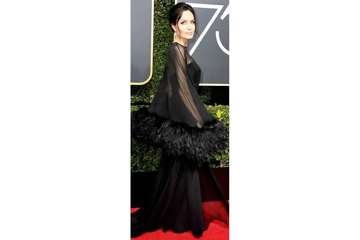 Witch queen black: Actress Angelina Jolie - one of the biggest names to have accused producer Harvey Weinstein of sexual harassment - conjures mystique and drama in a Versace gown with feathery sleeves. Star-spangled black: Nicole Kidman, Kerry Washi
