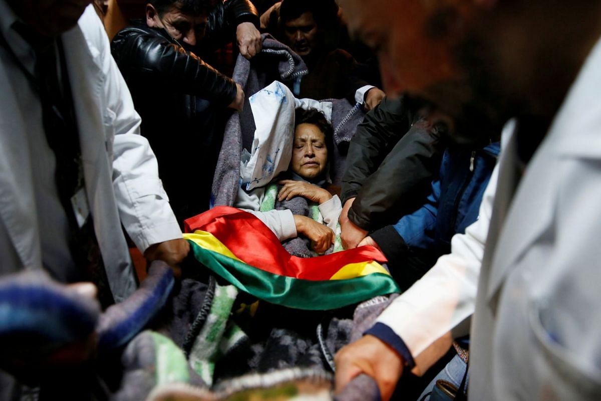 Teacher Wilma Plata is carried for medical assistance after her 19th day of hunger strike to protest against Bolivia's President Evo Morales policies in La Paz, Bolivia January 9, 2018. PHOTO: REUTERS