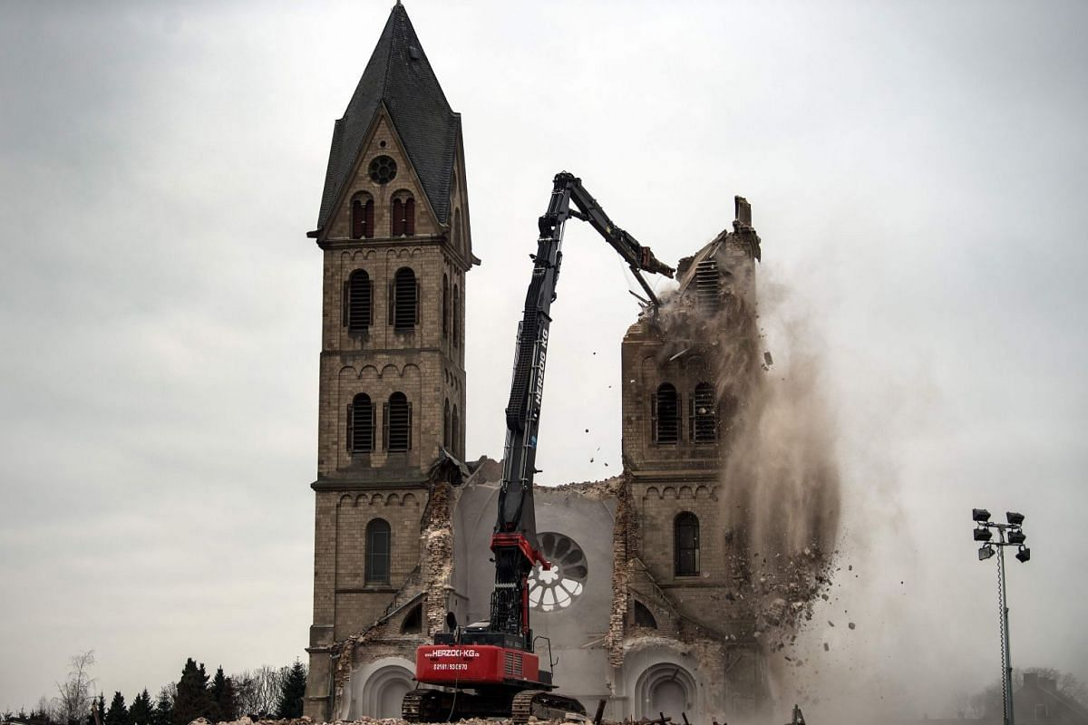 The desacralized St Lambertus church in Erkelenz-Immerath, western Germany, is being demolished on January 9, 2018, in order to make possible brown coal surface mining. PHOTO: AFP
