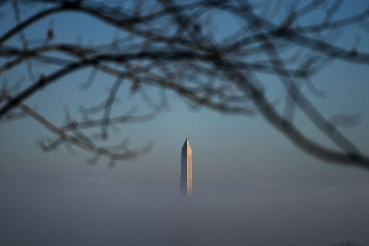 The Washington Monument pokes through morning fog in Washington, DC, USA, January 9, 2018. The Capitol region, along with much of the Mid-Atlantic, broke a two-week long cold-snap this morning. PHOTO: EPA-EFE