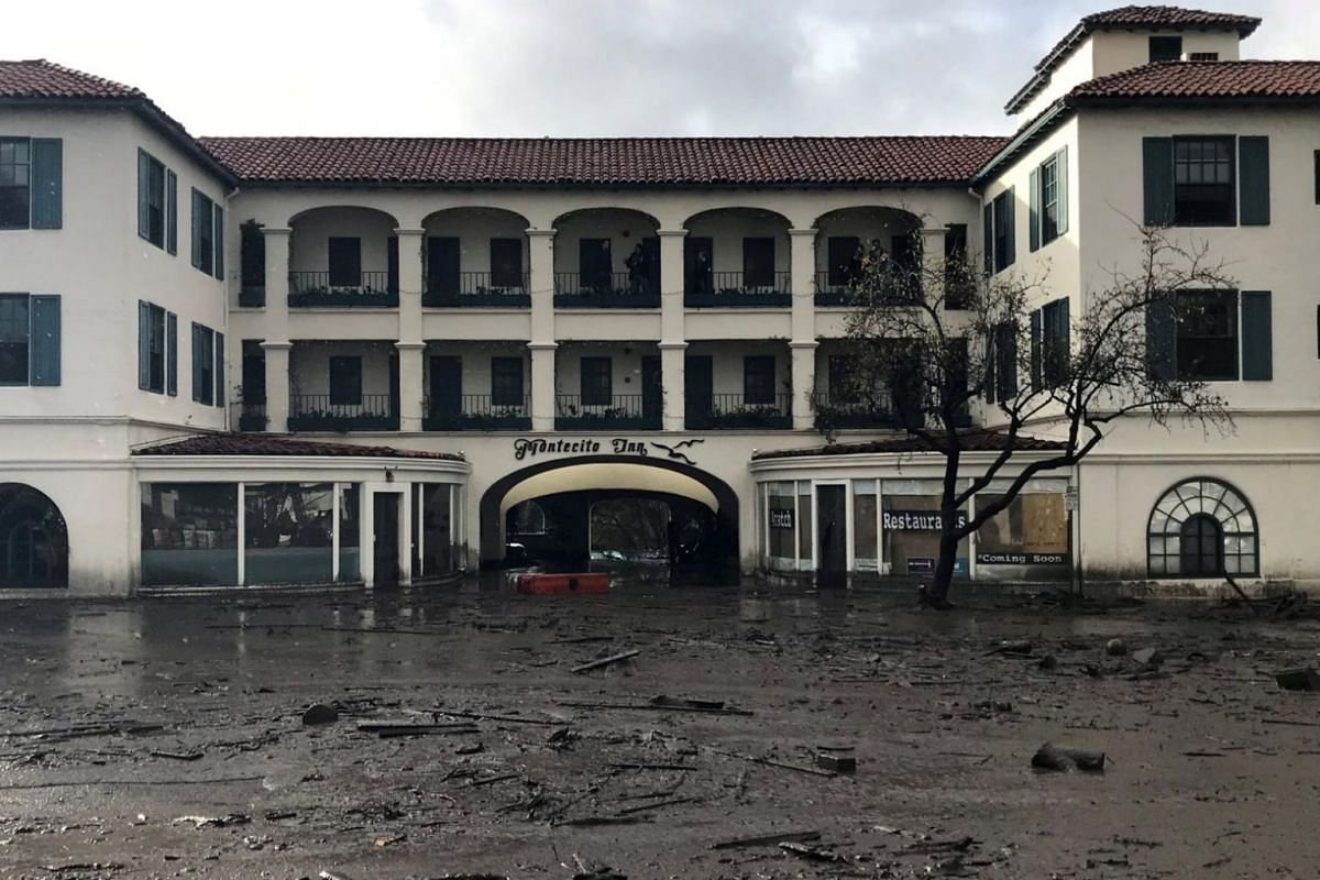 The Montecito Inn sits in flooded waters and debris after a mudslide.