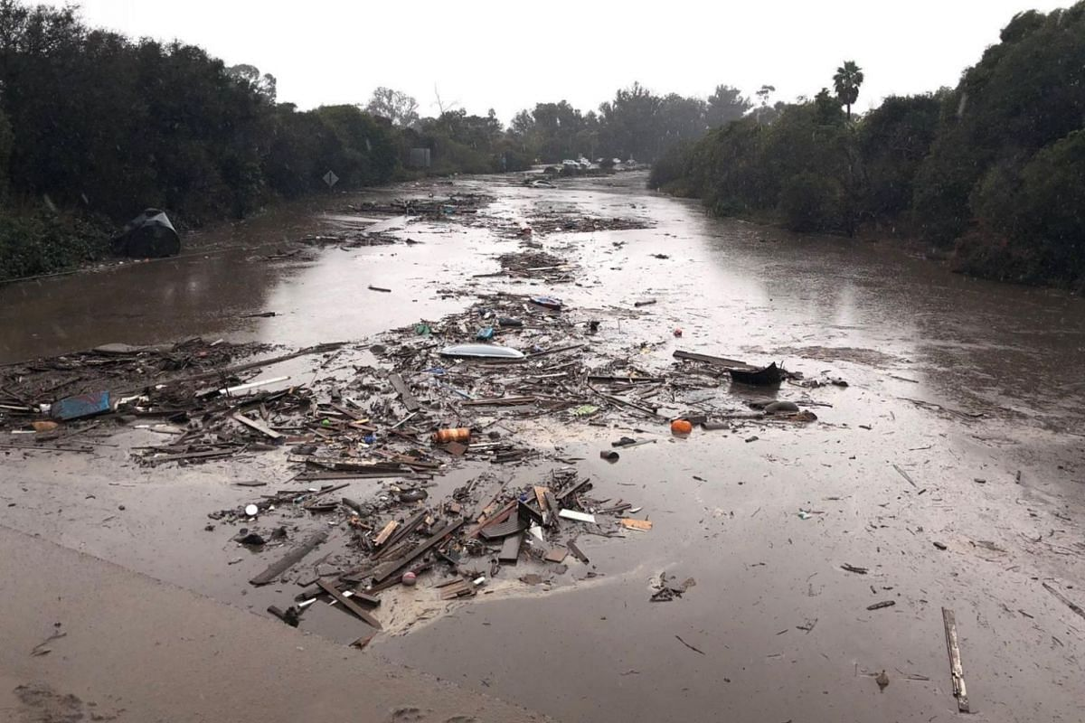 Debris floats in flooded waters on the freeway in Montecito, California.