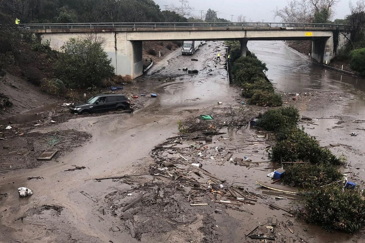 The US 101 Freeway at the Olive Mill Road overpass flooded with runoff water from Montecito Creek and blocked with mudflow and debris following heavy rains in Montecito, California on Jan 9, 2018.