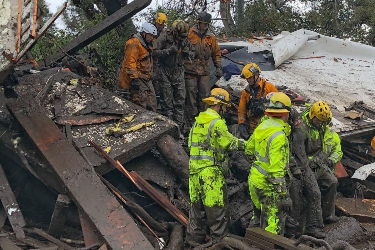 Emergency workers rescue a 14-year-old girl after she was trapped inside a home destroyed by a mudslide in Montecito, California.